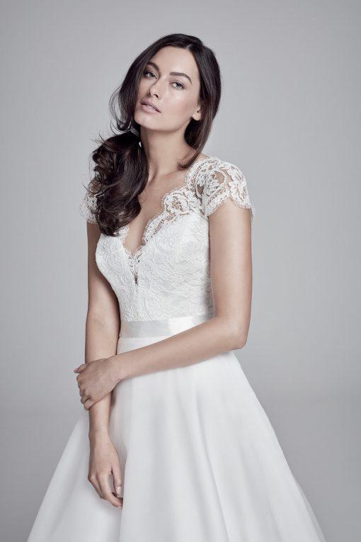 bride wearing Alicia wedding dress by Suzanne Neville