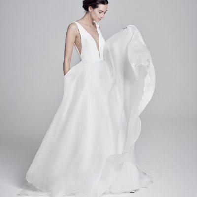 bride wearing Serrano wedding dress from designer Suzanne Neville