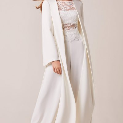 Grand crepe maxi-coat with splits, Chantilly lace bodice with crepe bandeau and palazzo trousers.