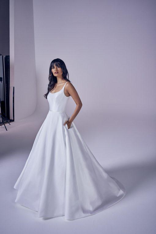 bride wearing suzanne neville Eternity