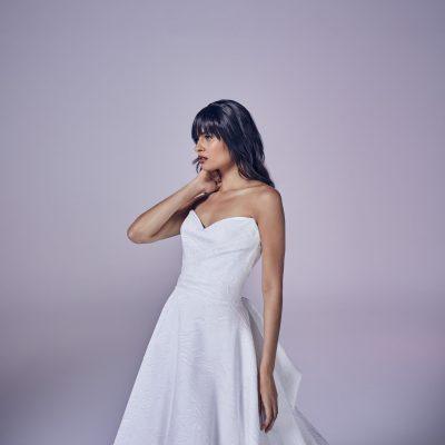 bride wearing suzanne neville Operetta
