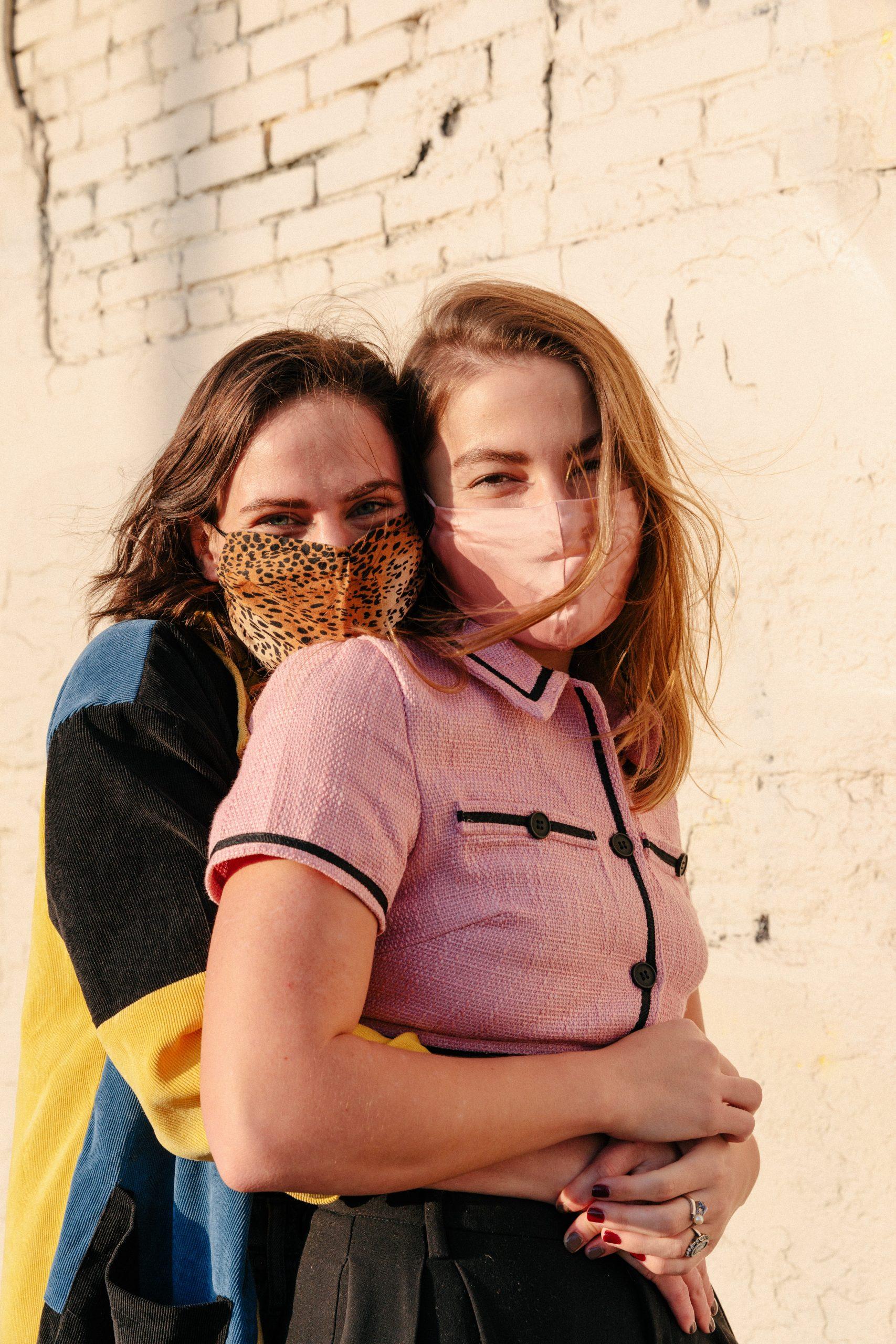 Happy women wearing masks